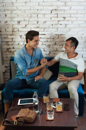 Two Men Handshake Congratulation at Cafe, Friend Mix Race photo