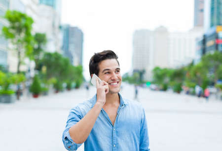 Handsome man cell phone call smile outdoor city street Stock Photo