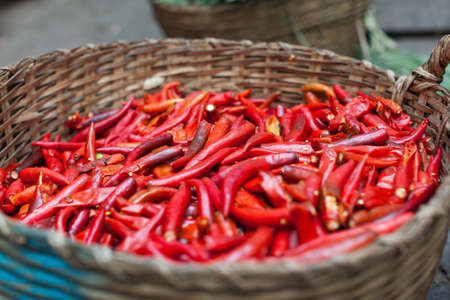 red chilly: basket of red chilly pepper asian street market