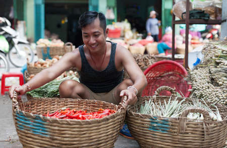 red chilly: Asian man street market sell basket red chilly pepper