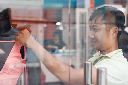 window shopper: Asian man tailor fashion clothes dress designer