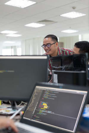 Asian Colleagues Software Developers Team Desk Working Laptop Computer Business People Real Office