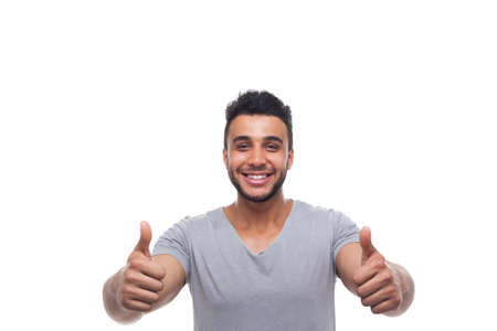 posing  agree: Casual Man Hold Thumb Up Happy Smile Young Handsome Guy Wear Shirt Isolated White Background