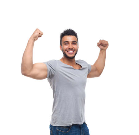 muscle shirt: Casual Man Strong Biceps Muscle Happy Smile Young Handsome Guy Wear Shirt Jeans Isolated White Background