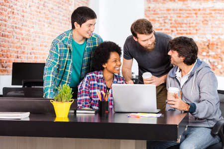 mix race: People office diverse mix race group businesspeople laughing discussing happy smile laptop computer casual wear Stock Photo