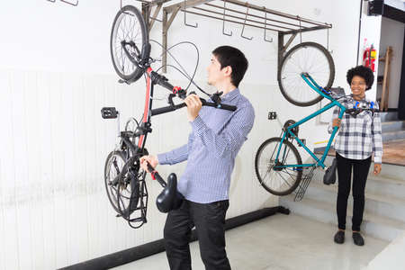 mix race: People hang bicycle on wall office diverse mix race group businesspeople casual wear
