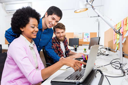 mix race: People office diverse mix race group businesspeople working woman point finger laptop casual wear