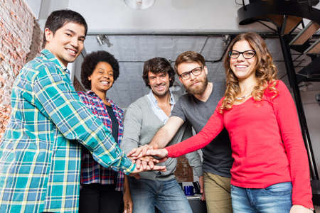 mix race: Diverse people team hands on top of each other support teamwork mix race group smile office