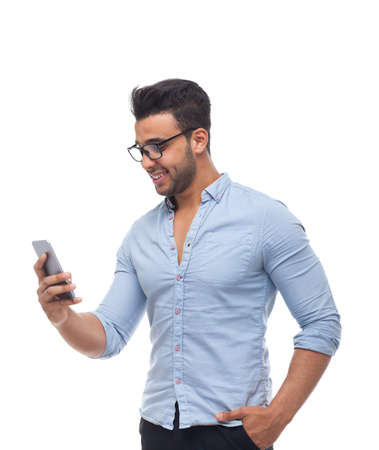 Handsome business man, businessman using cell smart phone wear glasses blue shirt isolated over white background Stock Photo