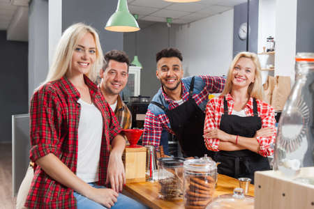 mix race: People friends drinking coffee shop talking laughing with barista sitting at bar counter, mix race man and woman happy smile