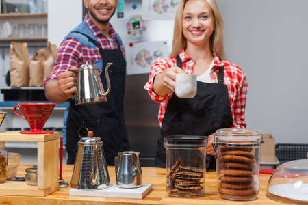 mix race: Barista coffee shop owner couple happy smile at bar counter mix race man woman small business