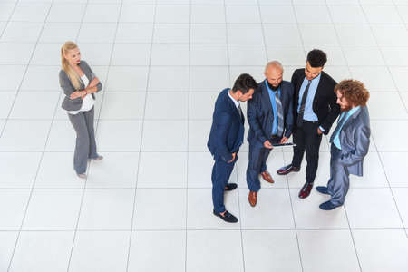 Business Men Group Discussion Meeting Using Tablet Computer, Businessmen Community Together, Businesswoman Stand Aside Concept Gender Women Rights Discrimination Top Angle View Modern Office Standard-Bild