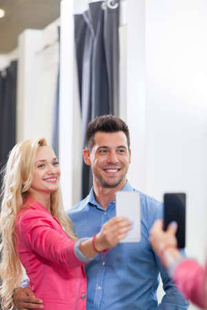 fitting room: Young Couple Taking Selfie Photo Fitting Room Fashion Shop, Happy Smiling Man And Woman Shopping Customers Trying Clothes In Retail Store