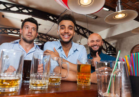 mix race: Man Group In Bar Hold Glasses Happy Smiling, Drinking Beer, Mix Race Cheerful Friends Meeting Pub Communicate Talking