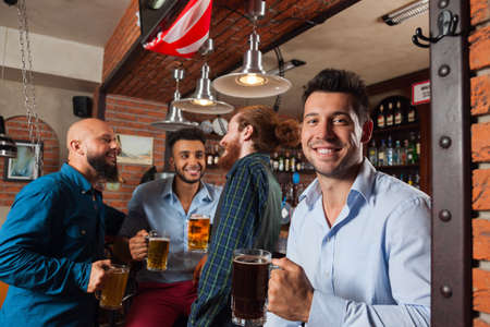 mix race: Man Group In Bar Hold Glasses Talking, Drinking Beer Mugs, Mix Race Cheerful Friends Wear Shirts Meeting Pub Communicate Talking