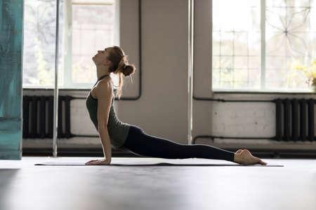 female legs: Woman Doing Yoga Exercises In Gym, Sport Fitness Girl Training Stretching Studio