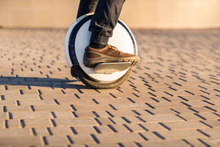 Man legs mono wheel personal electrical transport street outdoor