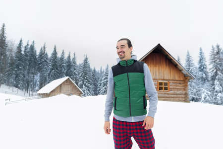 village man: Young Man Snowy Village Wooden Country House Winter Snow Resort Cottage Holiday Vacation