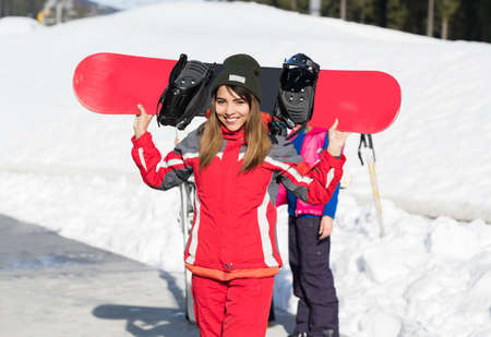 Asian Girl Tourist Snowboard Ski Resort Snow Winter Mountain Happy Smiling Woman On Holiday Extreme Sport Vacation Stock Photo