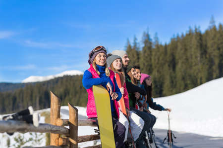 People Group With Snowboard And Ski Resort Snow Winter Mountain Cheerful Friends Extreme Sport Vacation Stock Photo
