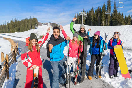 Group Of People Ski And Snowboard Resort Winter Snow Mountain Cheerful Happy Smiling Friends On Holiday Extreme Sport Vacation Stock Photo