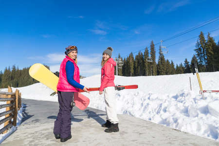 Two Woman Ski And Snowboard Resort Winter Snow Mountain Girls Holiday Extreme Sport Vacation Stock Photo