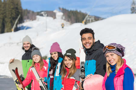 Group Of People Ski And Snowboard Resort Winter Snow Mountain Happy Smiling Friends On Holiday Extreme Sport Vacation Stock Photo