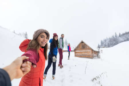 People Group Near Wooden Country House Winter Snow Resort Cottage Friends On Vacation