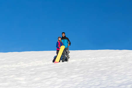 Couple With Snowboard And Ski Resort Snow Winter Mountain Cheerful Hispanic Man Woman Extreme Sport Vacation