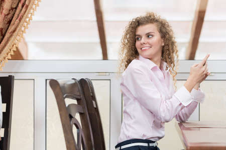 turning table: Business Woman Turning Back Chatting Cell Phone Messaging, Happy Smiling Young Beautiful Girl Sit On Table Restaurant Interior