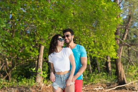 Couple Embracing Tropical Green Forest Summer Vacation, Beautiful Young People In Love, Man Woman Happy Smile Holiday Travel Stock Photo