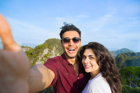 cavern: Young Couple Mountain View Point Happy Smiling Man And Woman Taking Selfie Photo On Cell Smart Phone Asian Holiday Summer Vacation Travel