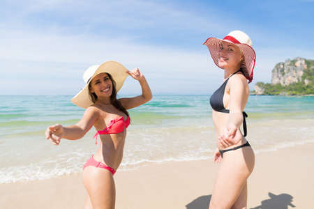summer wear: Girl Couple On Beach Summer Vacation, Young Woman Wear Hat Sea Ocean Holiday Travel