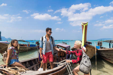 Young People Group Tourist Sail Long Tail Thailand Boat Ocean Friends Sea Vacation Travel Trip Tropical Holiday Stock Photo