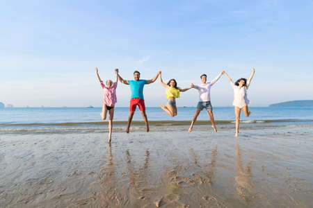 Young People Group Jump On Beach Summer Vacation, Happy Smiling Friends Sea Ocean Holiday Travel