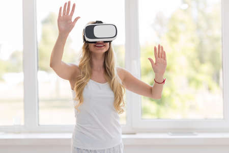 Young Blonde Woman Wear Virtual Reality Digital Glasses, Happy Smiling Beautiful Girl Over Big Window