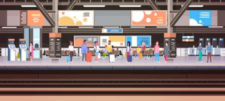 Stazione ferroviaria con la gente che aspetta sul bagaglio della tenuta della piattaforma