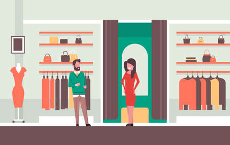 man seller consultant near woman trying on new dress elegant woman looking at mirror fashion shop female clothes market modern shopping mall interior flat horizontal vector illustration