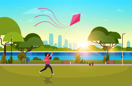 young woman launching kite outdoors modern public park girl playing wind toy holiday concept cityscape sunset background horizontal flat vector illustration