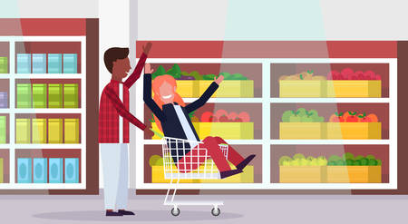 man carrying trolley cart with woman happy mix race couple having fun supermarket interior shopping concept male female cartoon characters full length horizontal vector illustration