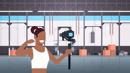woman fitness blogger shooting selfie video african american girl in front of camera recording herself using gimbal stabilizer blogging concept modern gym interior horizontal vector illustration