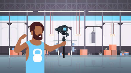 man fitness blogger shooting selfie video african american guy in front of camera recording himself using gimbal stabilizer blogging concept modern gym interior horizontal vector illustration Çizim