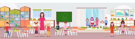 women teachers teaching mix race boys and girls preschool modern kindergarten children classroom with chalkboard desks chairs playground kid room interior full length flat horizontal vector illustration Illustration