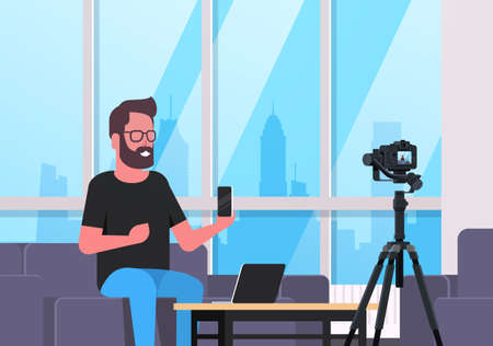 guy technology blogger recording video on camera man showing new smartphone functional testing blog concept modern apartment interior closeup horizontal vector illustration