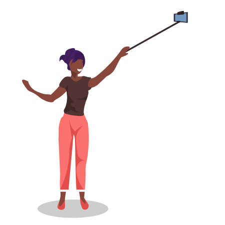 african american woman taking selfie photo with self stick by smartphone camera girl posing over white background full length flat vector illustration Stock Illustratie