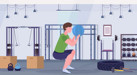 sporty man doing squats exercises with medicine leather ball guy training cardio workout concept modern gym health studio club interior horizontal full length vector illustration