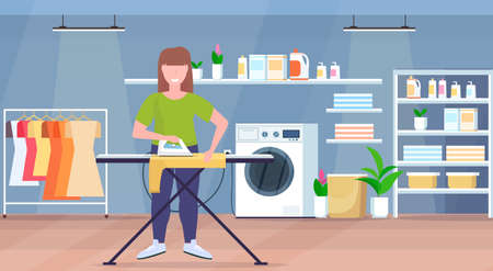 housewife ironing clothes young woman holding iron smiling girl doing housework concept modern laundry room interior female cartoon character full length flat horizontal vector illustration