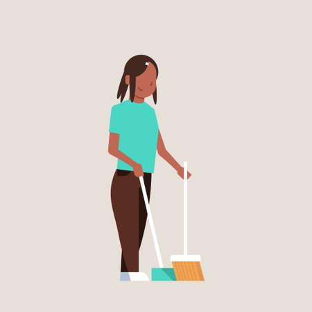 housewife sweeping floor with broom and scoop african american girl doing housework house cleaning concept female cartoon character full length flat gray background vector illustration Stock Illustratie