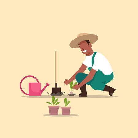 male farmer planting young seedlings plants flowers and vegetables african american man working in garden agricultural worker in uniform eco farming concept flat full length vector illustration