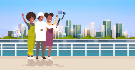 casual people using 3-axis gimbal stabilizer selfie stick for smartphone happy african american tourists taking photo standing together over cityscape background horizontal full length vector illustration